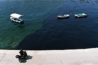 Pictured: The oil spill moving slowly towards the coast of Salamina, Greece<br /> Re: An oil spill off Salamina island&rsquo;s eastern coast is spreading and has become &ldquo;an environmental disaster&rdquo; according to local authorities in Greece.<br /> The spill was caused by the sinking of the Aghia Zoni II tanker, carrying 2,200 metric tons of fuel oil and 370 metric tons of marine gas oil on Saturday, southwest of the islet of Atalanti near Psytalleia. According to reports, the coastline stretching from Kinosoura to the Selinia community has &ldquo;turned black&rdquo; and authorities fear a new leak from the sunken ship.<br /> According to the island&rsquo;s mayor, Isidora Papathanasiou, the weather &ldquo;turned on Sunday afternoon and brought the oil spill to Salamina.&rdquo;