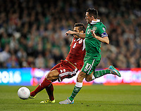 07/09/2015; UEFA Euro 2016 Group D Qualifier - Republic of Ireland v Georgia, Aviva Stadium, Dublin. <br /> Georgia&rsquo;s Aleksandre Amisulashvili with Robbie Keane of Ireland<br /> Picture credit: Tommy Grealy/actionshots.ie.