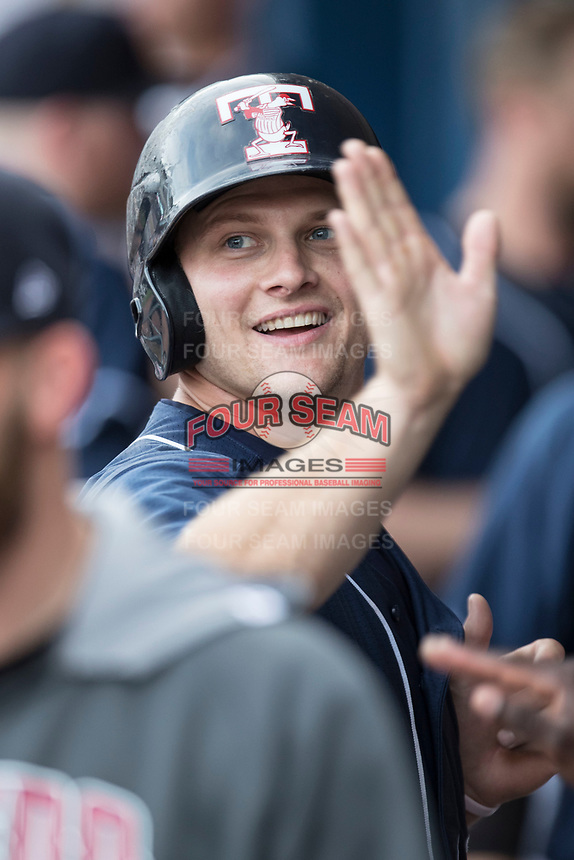 Toledo Mud Hens first baseman John Hicks (9) is greeted in the dugout by his teammates against the Louisville Bats during the International League baseball game on May 17, 2017 at Fifth Third Field in Toledo, Ohio. Toledo defeated Louisville 16-2. (Andrew Woolley/Four Seam Images)