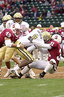 Jared Newberry and Garry Cobb make a tackle during Stanford's loss to Georgia Tech in the Seattle Bowl on December 27, 2001 in Seattle, WA.<br />Photo credit mandatory: Gonzalesphoto.com