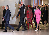 United States President Barack Obama walks with Rep. Frederica Wilson (D-FL), Senate Minority Leader Charles Schumer (D-NY) and House Minority Leader Nancy Pelosi (D-CA) as they make their way to a meeting with Congressional Democrats on Capitol Hill in Washington, D.C. on January 4, 2017. <br /> Credit: Kevin Dietsch / Pool via CNP