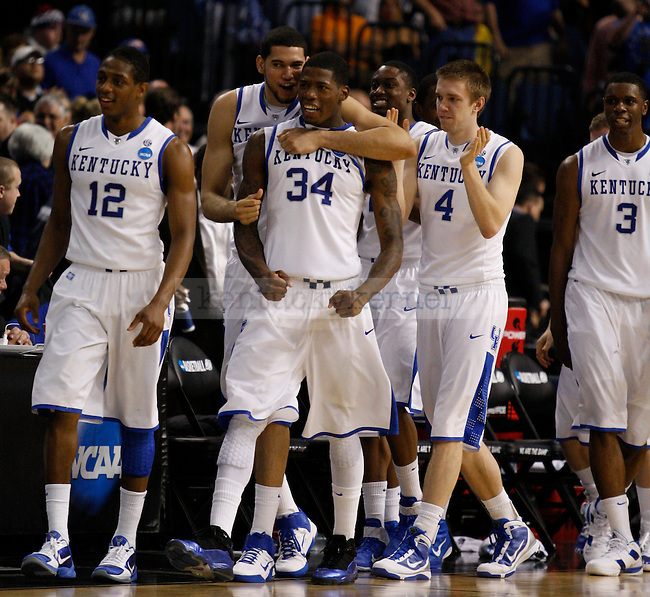 Kentucky walks to shake hands with West Virginia players after beating them 71-63 in their second game of the 2011 NCAA Basketball Tournament, at the St. Pete Times Forum, in Tampa, Fl.  Photo by Latara Appleby | Staff