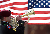 "A member of the honor guard plays ""Taps"" on the bugle during a funeral service for Eric O'Hara at Fort Logan National Cemetery in Denver on Thursday afternoon."