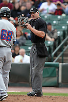 Home plate umpire Stephen Barga during a game with the Rochester Red Wings vs. the Buffalo Bisons at Frontier Field in Rochester, New York;  September 6, 2010.  Buffalo defeated Rochester 16-1 in the season finale for both teams.  Photo By Mike Janes/Four Seam Images