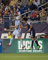 New England Revolution defender Kevin Alston (30) header deflects off of Colorado Rapids midfielder Wells Thompson (15). The Colorado Rapids defeated the New England Revolution, 2-1, at Gillette Stadium on April 24, 2010.