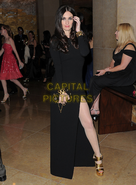 Paz Vega.Exiting The 70th Annual Golden Globe Awards held at The Beverly Hilton Hotel in Beverly Hills, California, USA..January 13th, 2013.globes full length black dress slit split gold sandals shoes cuffs hand arm.CAP/DVS.©DVS/Capital Pictures.