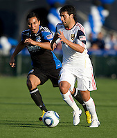 Javier Morales of Salt Lake dribbles the ball away from Arturo Alvarez of the Earthquakes during the first half of the game at Buck Shaw Stadium in Santa Clara, California on March 27th, 2010.  Real Salt Lake defeated San Jose Earthquakes, 3-0.