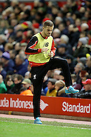 Jordan Henderson warms up as a substitute during the Barclays Premier League Match between Liverpool and Swansea City played at Anfield, Liverpool on 29th November 2015