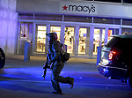 (Braintree MA 02/03/17) A SWAT member runs by the Macy's store in the South Shore Plaza, after shots were fired inside the mall Friday evening. Herald Photo by Jim Michaud