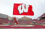 November 14, 2009: A Wisconsin Badgers carries a flag after a Badgers touchdown during an NCAA football game against the Michigan Wolverines at Camp Randall Stadium on November 14, 2009 in Madison, Wisconsin. The Badgers won 45-24. (Photo by David Stluka)