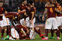 Calcio, Serie A: Roma vs Frosinone. Roma, stadio Olimpico, 30 gennaio 2016.<br /> Roma&rsquo;s Stephan El Shaarawy, bottom center, celebrates with teammates after scoring during the Italian Serie A football match between Roma and Frosinone at Rome's Olympic stadium, 30 January 2016.<br /> UPDATE IMAGES PRESS/Isabella Bonotto