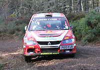 John Morrison - Peter Carstairs in a Mitsubishi Lancer Evolution 9 competing at Junction 6 on the Munro Scotch Beef Millbuie Special Stage 1 on the 2014 Arnold Clark/Thistle Hotel Snowman Rally, supported by Highland Office Equipment, part of Capital Document Solutions which was organised by Highland Car Club and based in Inverness on 22.2.14; Round 1 of the 2014 RAC MSA Scottish Rally Championship sponsored by ARR Craib Transport Limited.
