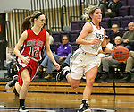 SIOUX FALLS, SD - DECEMBER 8:  Madi Robson #10 from the University of Sioux Falls pushes the ball past Kari Clements #12 from Minot State Friday night at the Stewart Center.(Photo by Dave Eggen/Inertia)
