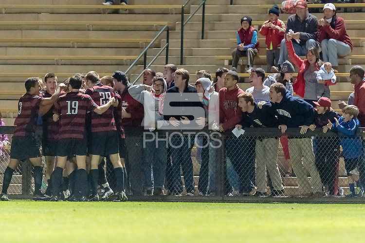 November 13, 2013: Team celebrates with fans during the Stanford vs Cal men's soccer match in Stanford, California.  Stanford won 2-1 in overtime.