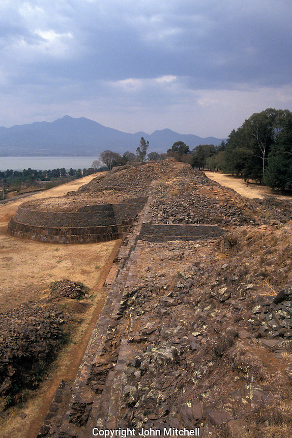 The Tarascan ruins of Tzintzuntzan with Lake Patzcuaro in the background, Michoacan , Mexico. These Purepecha pyramids are known as yacatas.