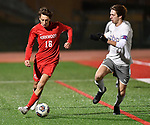 Kirkwood midfielder Peyton Boyd (left) dribbles the ball as he's shadowed by CBC defender Samuel Benoist. CBC played Kirkwood in a Class 4 sectional soccer game at Kirkwood High School in Kirkwood on Thursday November 14, 2019.<br /> Tim Vizer/Special to STLhighschoolsports.com