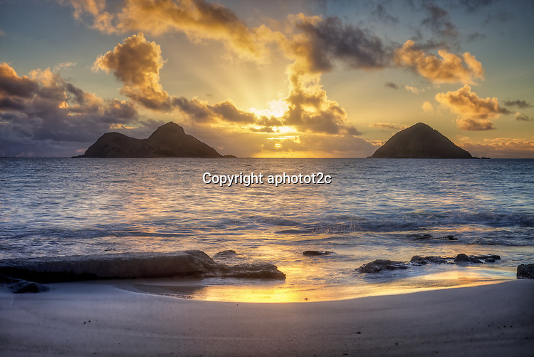 Stunning Lanikai Sunrise of Mokulua Islands from public access paths to the beach.