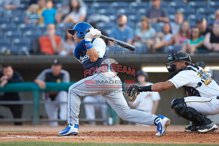 Cristian Perez (15) of the Lexington Legends follows through on his swing against the West Virginia Power at Appalachian Power Park on June 7, 2018 in Charleston, West Virginia. The Power defeated the Legends 5-1. (Brian Westerholt/Four Seam Images)