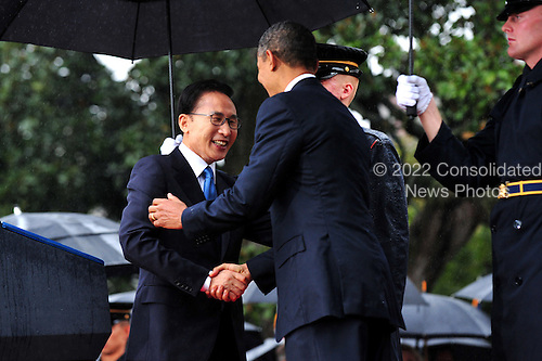 United States President Barack Obama greets South Korean President Lee Myung-bak during an arrival ceremony on the South Lawn of the White House in Washington, D.C. on Thursday, October 13, 2011.  .Credit: Kevin Dietsch / Pool via CNP