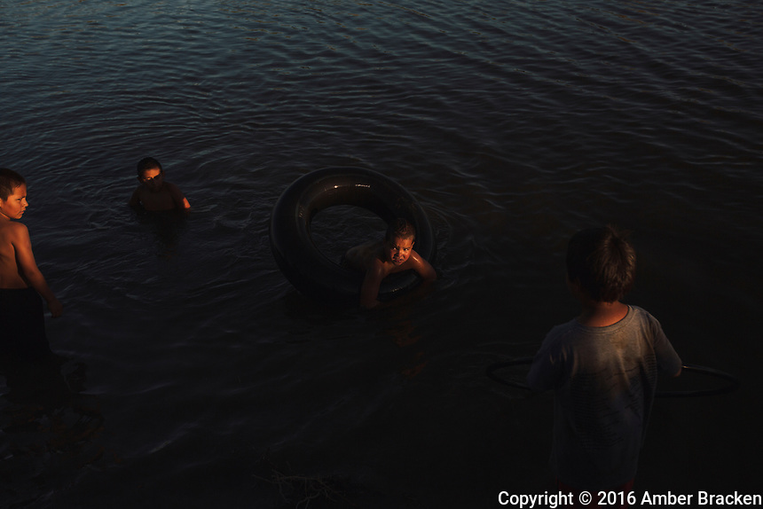 Evening swim in the Cannonball in the DAPL resistance camps in North Dakota on Saturday, September 17, 2016. The family, all members of the Standing Rock tribe, had just arrived from South Dakota.