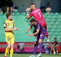 3rd November 2019; HBF Park, Perth, Western Australia, Australia; A League Football, Perth Glory versus Central Coast Mariners; Mark Birighitti of the Central Coast Mariners takes the ball over Christopher Ikonomidis of the Perth Glory - Editorial Use