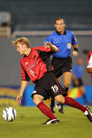DALLAS, TX SEPTEMBER 25: Bobby Rhine #19 of the Dallas Burn in action against the Chicago Fire at Cotton Bowl in Dallas on September 25, 2004 in Dallas, Texas. Burn wins 3-1. (Photo by Rick Yeatts) Rhine's career consisted of 212 games making 136 starts, played more than 12,000 minutes scoring 23 goals and 34 recorded assists.