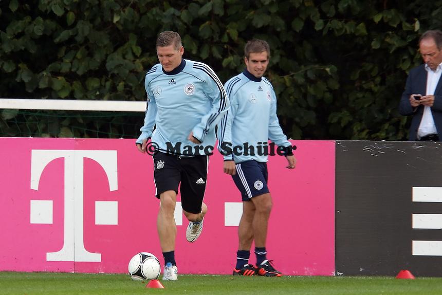 Bastian Schweinsteiger (D) und Philipp Lahm