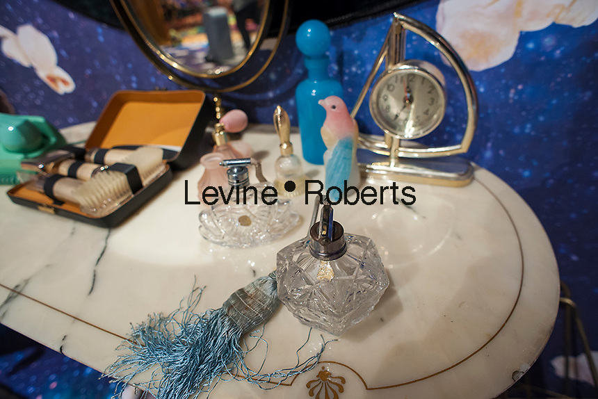 A display of collectible antiques, including glass perfume bottles with other vanity table items, on display in New York on Saturday, February 25, 2017. (© Richard B. Levine)