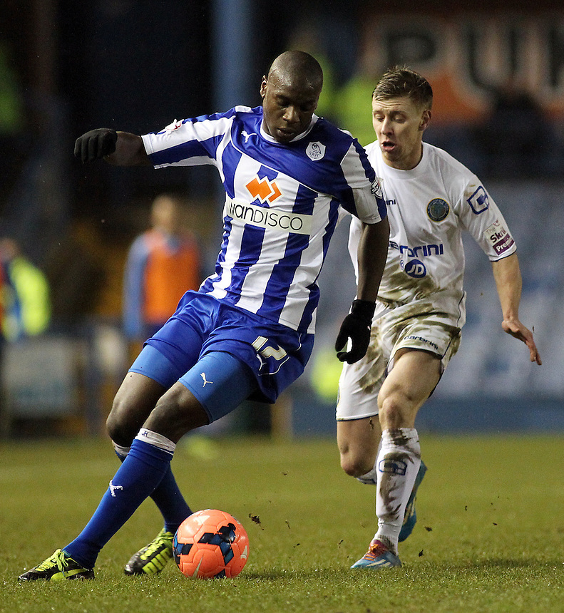Sheffield Wednesday's Jeremy Helan vies for possession with Macclesfield Town's Jack Mackreth<br /> <br /> Photo by Rich Linley/CameraSport<br /> <br /> Football - FA Challenge Cup Third Round replay - Sheffield Wednesday v Macclesfield Town - Tuesday 14th January 2014 - Hillsborough - Sheffield<br /> <br />  &copy; CameraSport - 43 Linden Ave. Countesthorpe. Leicester. England. LE8 5PG - Tel: +44 (0) 116 277 4147 - admin@camerasport.com - www.camerasport.com