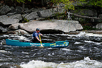 Canoeist competing in the Hudson River White Water Derby in the Adirondack Forest Preserve, New York