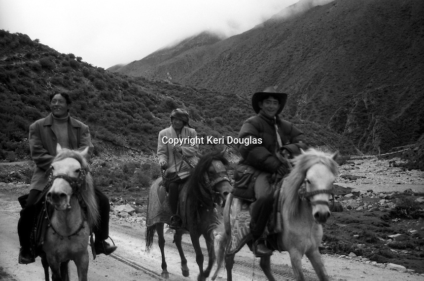 Wild Pony Riders arrive for morning trek up to 16,000 feet to meet mystic nun at hermitage above the glaciers, Drikung Drigung Valley, Tibet.