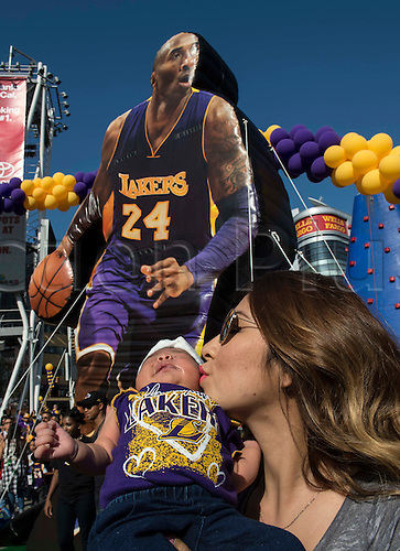 13.04.2016. Los Angeles, California, USA. Brooklyn Verduzco, month old, gets a kiss from your mother Melissa Michel, of Pomona, as they join others in the streets during Fanfest outside Staples Center on Wednesday in Los Angeles. This was Kobe Bryant's final game.