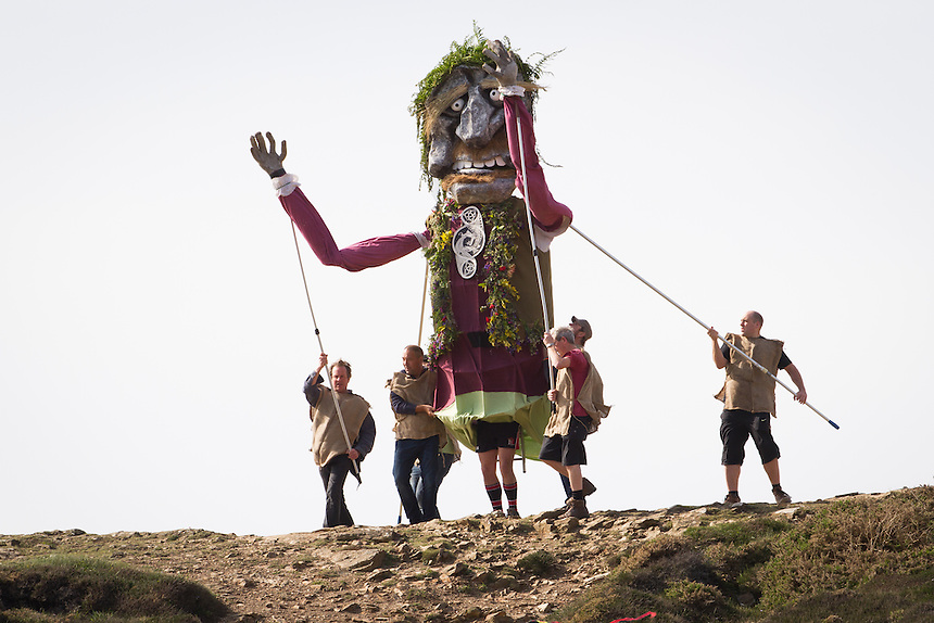 The Giant Bolster paces down a cliff face at Chapel Porth during a reenactment of the Myth of the Bolster. St Agnes Bolster Festival 2014, Cornwall. ©Scott Garfitt 2014
