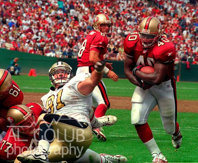 San Francisco 49ers vs. New Orleans Saints at Candlestick Park Sunday, September 14, 1997.  49ers beat Saints  33-7.  San Francisco 49ers full back William Floyd (40) gets by New Orleans Saints defensive end Brady Smith (91).