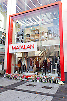 Pictured: Flowers outside Matalan store in Cardiff, Wales, UK where a couple were killed. Thursday 29 September 2016<br />Re: Police are continuing to question a man on suspicion of murdering a couple who were found stabbed on a Cardiff street near to where they worked.<br />Matalan workers Zoe Morgan, 21, and Lee Simmons, 33, were found dead close to the store on Queen Street at about 05:50 BST on Wednesday.<br />Andrew Saunders from Castleton, Newport, who is known to the couple, is in custody.<br />He was arrested within an hour of their bodies being found and officers are not looking for anyone else.Pictured: <br />Re: Police are continuing to question a man on suspicion of murdering a couple who were found stabbed on a Cardiff street near to where they worked.<br />Matalan workers Zoe Morgan, 21, and Lee Simmons, 33, were found dead close to the store on Queen Street at about 05:50 BST on Wednesday.<br />Andrew Saunders from Castleton, Newport, who is known to the couple, is in custody.<br />He was arrested within an hour of their bodies being found and officers are not looking for anyone else.