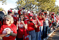 Ohio State fans wait with their cameras ready as the team makes their way into the stadium before the NCAA football game between the Ohio State Buckeyes and the Wisconsin Badgers at Ohio Stadium in Columbus, Saturday evening, September 28, 2013. (Columbus Dispatch  / Eamon Queeney)