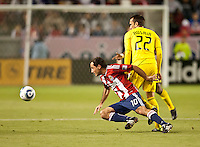 CARSON, CA – APRIL 9, 2011: Chivas USA midfielder Nick LaBrocca (10) moves to beat Columbus Crew midfielder Dejan Rusmir (22) to the ball during the match between Chivas USA and Columbus Crew at the Home Depot Center, April 9, 2011 in Carson, California. Final score Chivas USA 0, Columbus Crew 0.