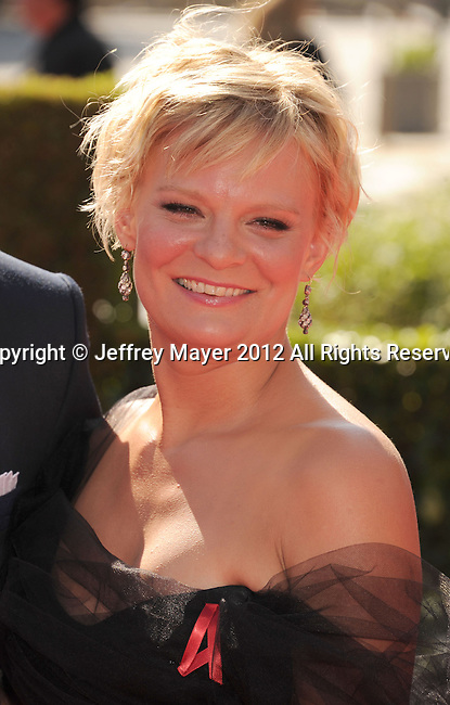 LOS ANGELES, CA - SEPTEMBER 15: Martha Plimpton arrives at the 2012 Primetime Creative Arts Emmy Awards at Nokia Theatre L.A. Live on September 15, 2012 in Los Angeles, California.