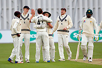 Will Gidman of Kent is mobbed after taking the wicket of Muhammad Amir (R) during day 1 of the four day tour match between Kent CCC and Pakistan at the St Lawrence Ground, Canterbury, on Sat April 28, 2018