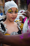 A young girl with makeup ready during the parade of Llamadas during Carnaval in Montevideo, Uruguay.