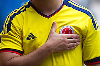 Miami, FL - Friday, July 4, 2014:  A Colombian fans hopes for a goal while watching the Brazil vs. Colombia Quarterfinal World Cup match in the Brickell neighborhood.