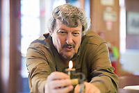 """NWA Democrat-Gazette/CHARLIE KAIJO Mike Patton of Rogers lights an antique """"courting candle"""", Friday, March 30, 2018 at the Rogers Historical Museum Education Annex in Rogers. Fathers once used courting candles as a way to put a time limit on how long male suitors can """"court"""" their daughters. <br /><br />Collectors from the group Finders Keepers share antiques with each other. They will hold meetings on the last Friday of every month from March until September at the Rogers Historical Museum Education Annex until the Rogers Historical Museum completes its expansion. Attendees may share antiques but the group does not provide appraisals for items."""