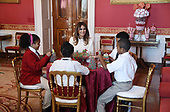 First Lady Melania Trump participates in arts and crafts projects with children and students from Joint Base Andrews in the Red Room of the White House in Washington, DC, November 27, 2017.<br /> Credit: Olivier Douliery / Pool via CNP