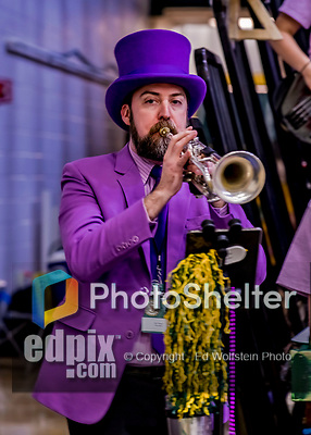 19 January 2019: University of Vermont Catamount Co-director of the Pep Band, plays trumpet in lavender attire to help celebrate the Rally Against Cancer game against the Binghamton University Bearcats at Patrick Gymnasium in Burlington, Vermont. The Catamounts defeated the Bearcats 78-50 to remain unbeaten in conference play to date this season. Mandatory Credit: Ed Wolfstein Photo *** RAW (NEF) Image File Available ***