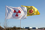 Flags fly at the Anti nuclear protest at Hinkley Point north Somerset . Protesters have occupied a  farmhouse as EDF clear the land well  before  they have been given planning  permission.