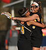 Nikki Sliwak #34 of Wantagh, right, celebrates with Taylor Rossi #24 after their team's 11-10 win over host Cold Spring Harbor High School in a Nassau County varsity girls lacrosse game on Thursday, Apr. 21, 2016. Sliwak scored the game-winning goal with 12.8 seconds remaining to propel Wantagh to victory.