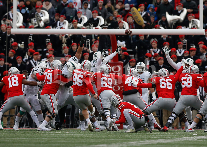 Ohio State Buckeyes place kicker Sean Nuernberger (96) kicks a field goal during the fourth quarter of a NCAA college football game between the Ohio State Buckeyes and the Michigan State Spartans on Saturday, November 11, 2017 at Ohio Stadium in Columbus, Ohio. [Joshua A. Bickel/Dispatch]