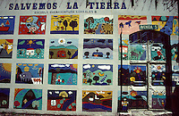 "Children's art display entitled ""Let's Save the Earth"" on the wall of Escuela Buenaventura Corrales B. school in San Jose, Costa Rica"