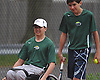 Nate Melnyk, left, and Bobby Bellino of Harborfields switch sides during their varsity boys tennis match against host Smithtown High School East on Tuesday, Apr. 29, 2016. Melnyk, a wheelchair-using junior, played in his first varsity match, which was suspended in the first set due to the inclement weather. The match is set to resume on Monday, May 2.