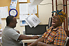Merrielle Clark, 45, shares a laugh with Charles Anthony, Program Director of STEPS in their office in Lakewood. The women who is on disablility, lived at two differant homeless sites prior to her apartment. Peter Ackerman / Asbury Park Press  homeless  homelessseries  Day03a